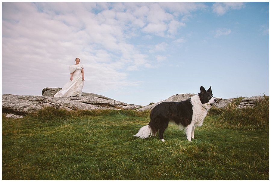 Wedding with Rescue Dogs - Bride with one of her rescue dogs standing on the rocky mountain top by Wild Connections Photography