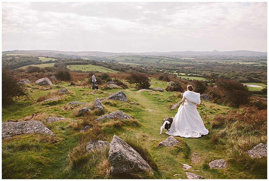 Wedding with Rescue Dogs - Bride walking towards her husband with their dogs by Wild Connections Photography