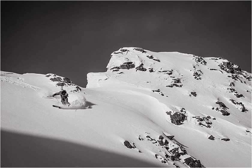 A skier skies down a ridge making fresh tracks on Stubai glacier by Wild Connections Photography