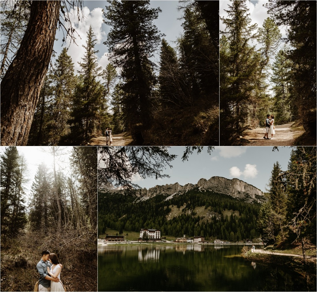 Engaged couple walk through the forests around Lake Misurina. Photo by Wild Connections Photography Dolomites Wedding Photographer