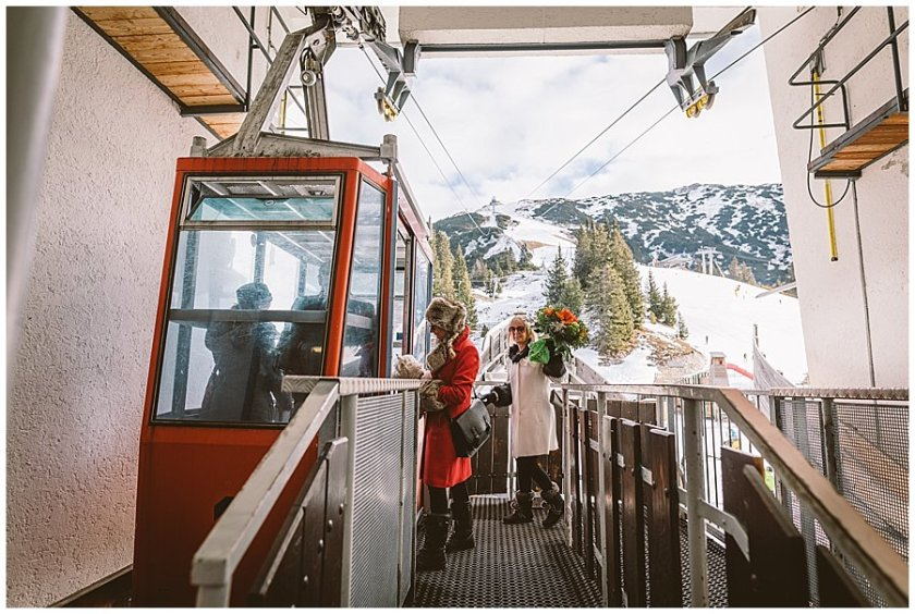 The wedding guests board the tiny vintage ski lift to the Rosshuette peak in Seefeld by Wild Connections Photography