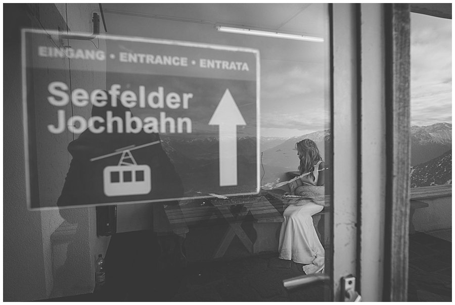 The bride waits in a room by the ski lift before the ceremony