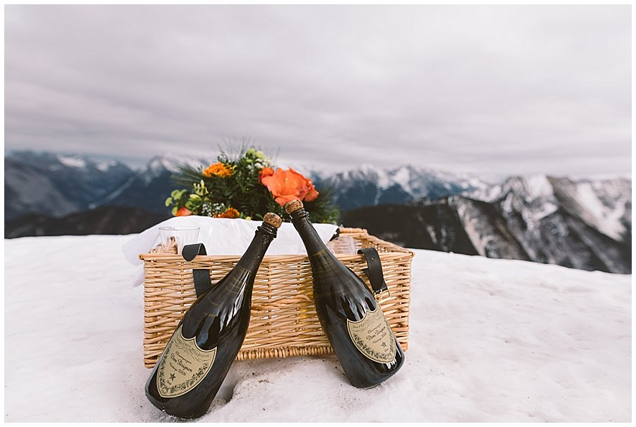 Two bottles of Dom Perignon champagne and a picnic hamper in the snow