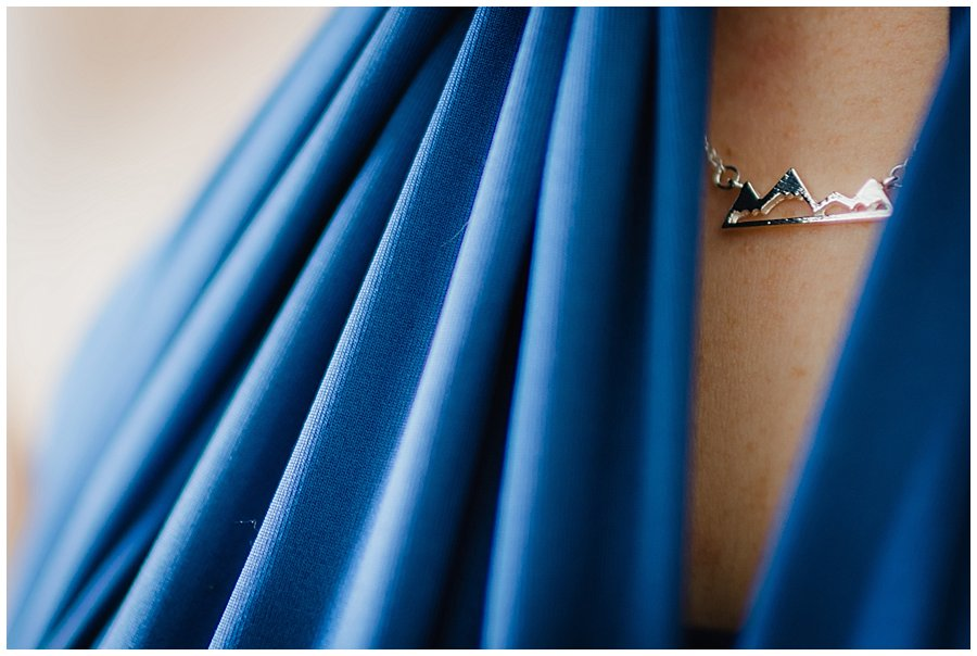 Close up of one of the bridesmaids wearing a mountain necklace