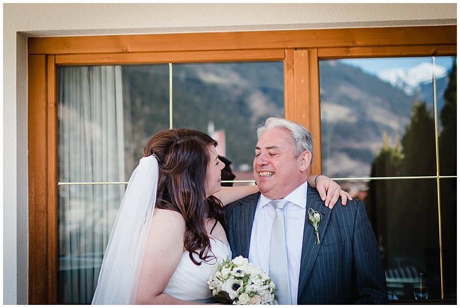 Bride hugs her dad
