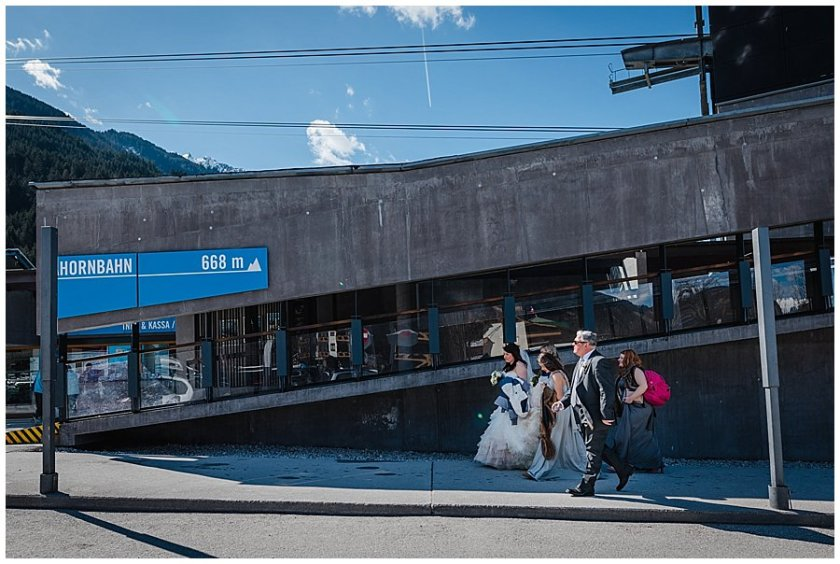 The bride and bridal party arrive at the cable car in Mayrhofen