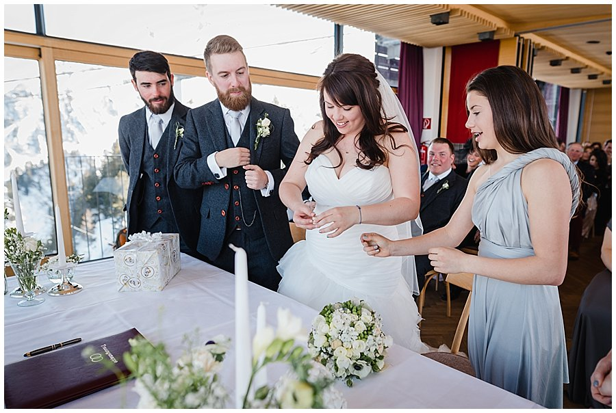 Izzy gives Bec and Dan the rings to exchange
