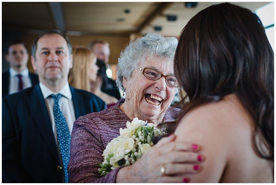 Bec's grandmother smiles as she congratulates her