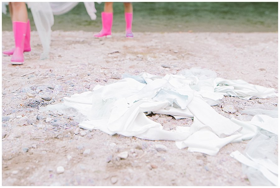 Trash The Dress Photo Shoot Austria - Pieces of the wedding dress on the floor by Wild Connections Photography