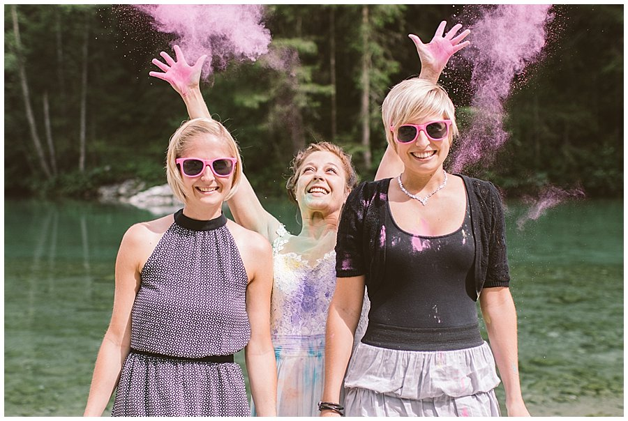 Trash The Dress Photo Shoot Austria - Bride throws pink powder paint over her sisters by Wild Connections Photography