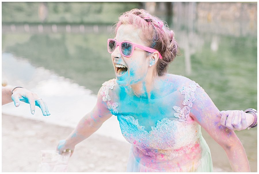 Trash The Dress Photo Shoot Austria - Bride laughing at being covered in powder paint by Wild Connections Photography