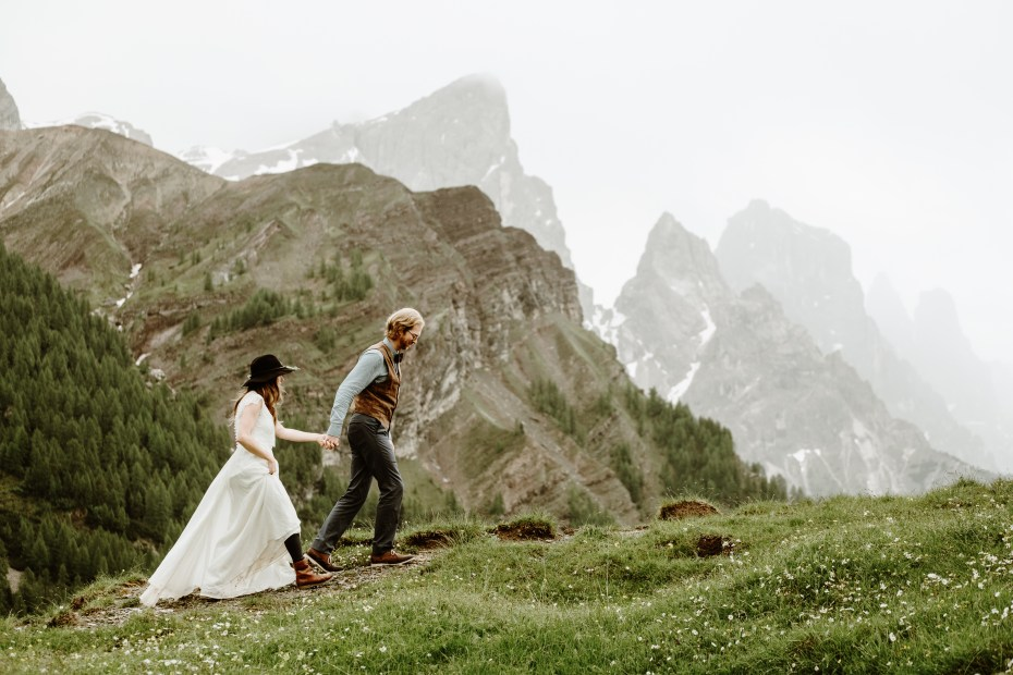 Bride & groom hiking in the Dolomites by Wild Connections Photography