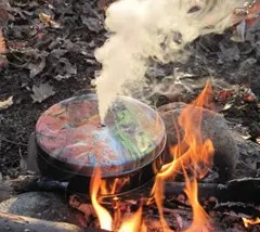 Smoke coming from tin can containing char cloth