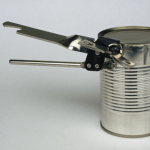 How to open a metal can without using a can opener.