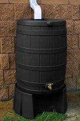Rain barrel attached to rain gutter