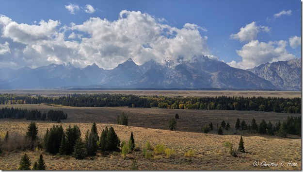 Clouds lift off the Tetons.