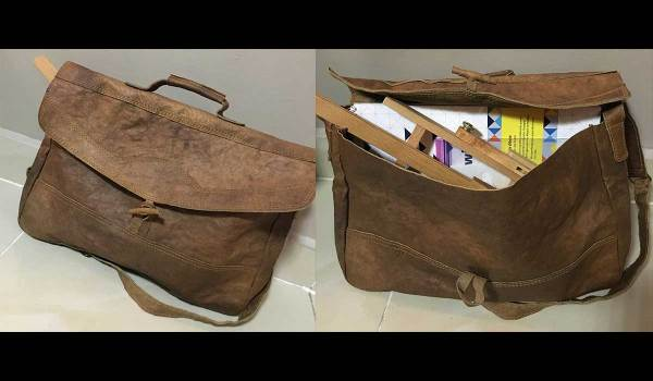It's easy to be a traveling artist with this awesome camel skin art satchel from my stay in Doha, Qatar.