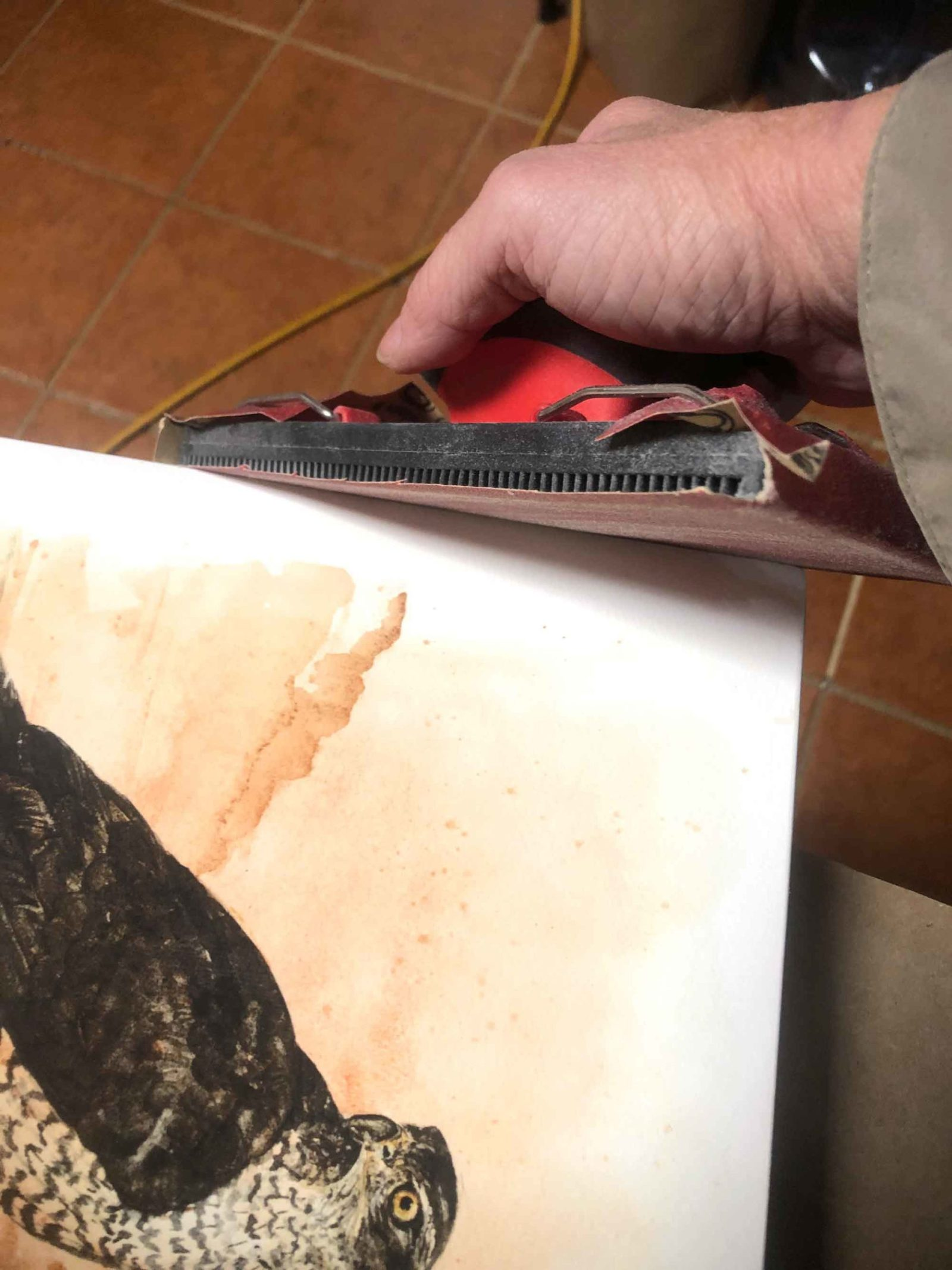 For this step in making mounted prints, use a holder for the sandpaper. It makes the job a lot easier!