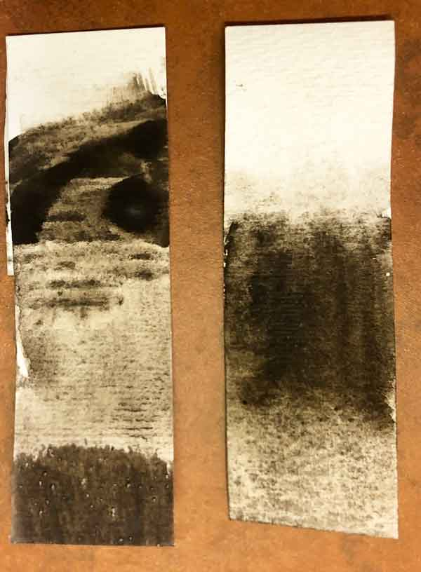 A swatch of paint from washed pigment from what is most likely bituminous coal.