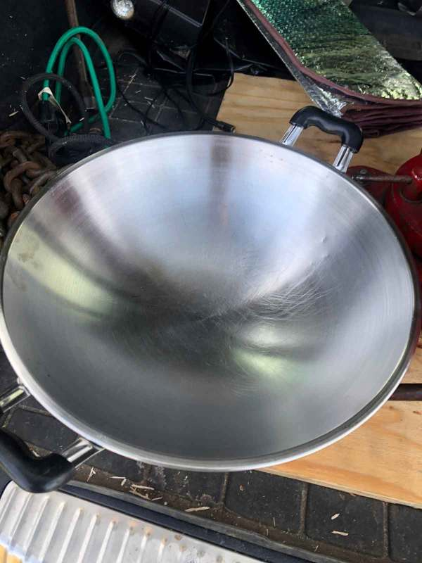 A stainless steel wok I use to gather the petals from the dayflower when I'm out foraging pigments.
