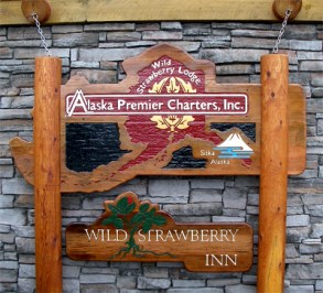 Alaska Premier Charters Inc and Wild Strawberry Lodge Sign in Sitka, AK