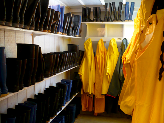 Alaska Premier Charters Rain Gear Room with Full Rain Gear and Boots