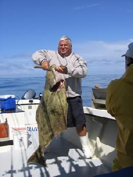 That Halibut in the Boat Equals a Job Well Done for Captain and Crew