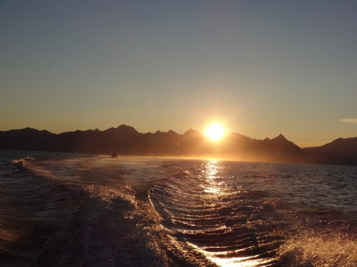 Sunset Over The Mountains Out On The Water