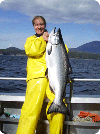 Displaying a King Salmon caught in Sitka Alaska with Wild Strawberry Lodge
