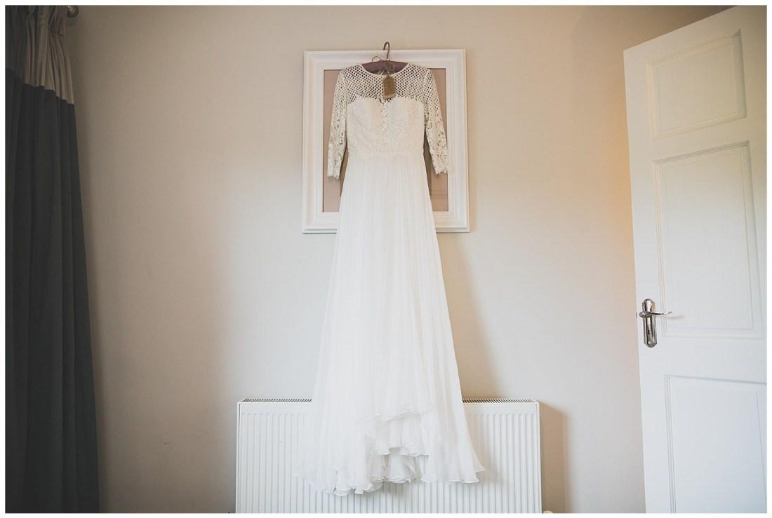 White and lace boho style floor length wedding dress
