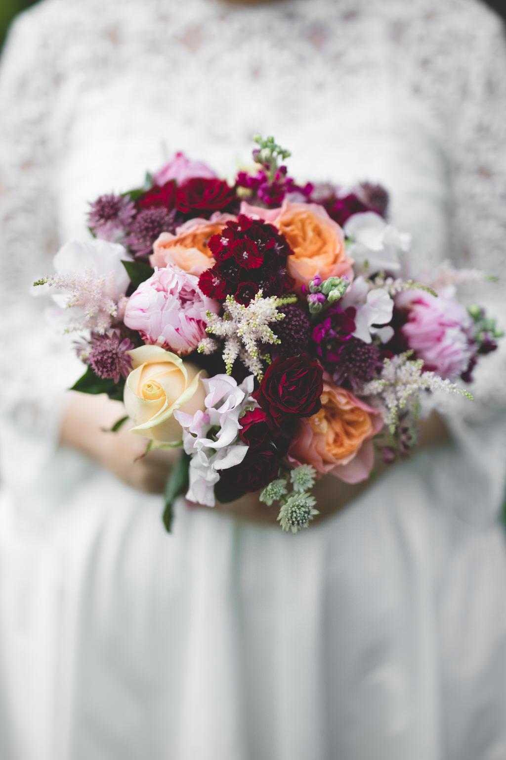 Orange, pink & burgundy, oxblood toned floral bouquet