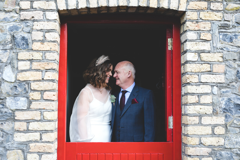 Portrait of a bride & her father before the wedding ceremony