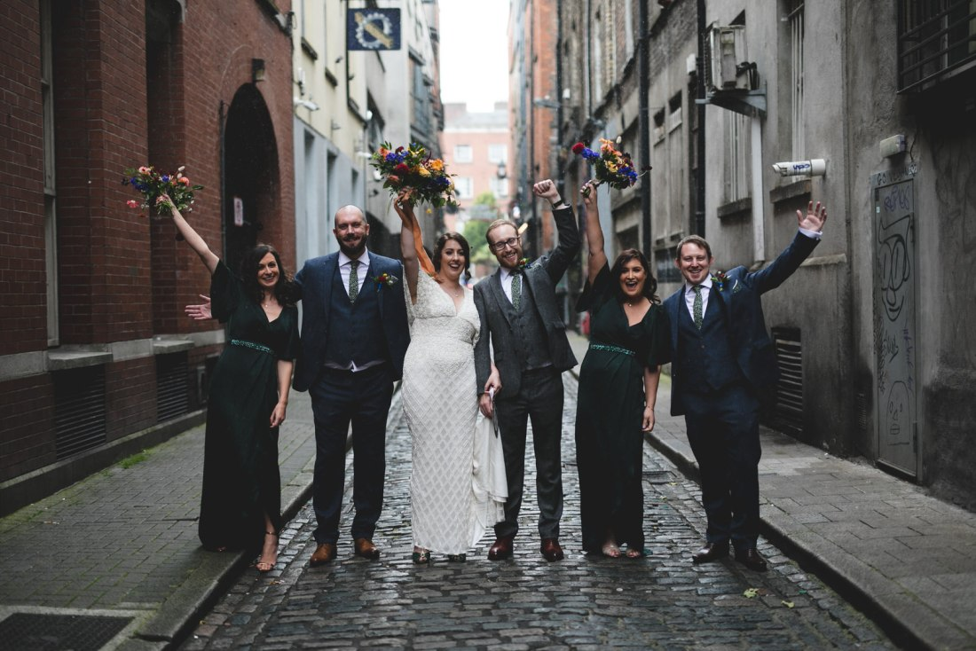 rainy wedding party portraits in temple bar