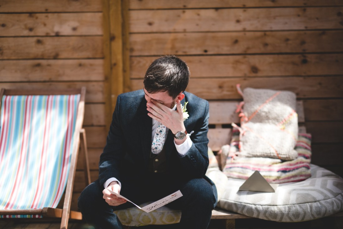 groom cries as he reads card on the wedding morning