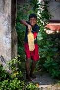 boy playing cricket Point Pedro Sri Lanka