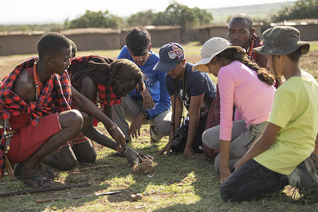 Kids interacting with Maasai villagers