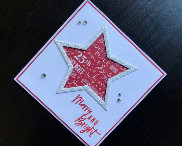 Christmas card with die cut glitter star frame