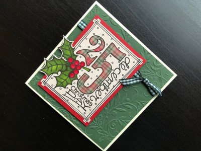Christmas card with stamped paper pieced Christmas date, embossed holly background and gingham ribbon