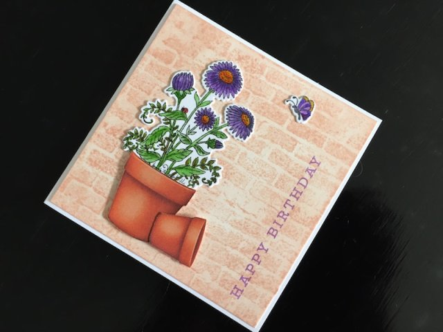 Hand made birthday card with stamped and die cut aster in a flower pot.
