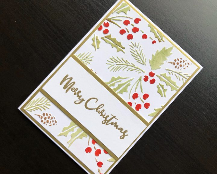 Hand made Christmas card with stencilled texture paste background