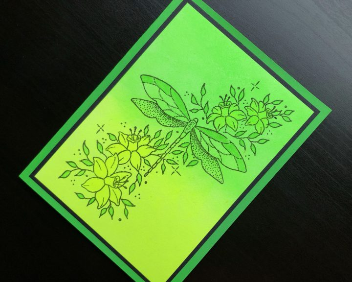 Hand made card with neon polish background and stamped dragonfly