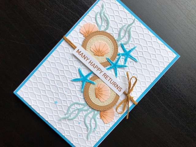Hand made birthday card with die cut shells and starfish