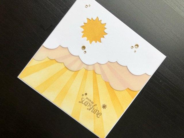 Hand made card with die cut sun and stencilled rays.