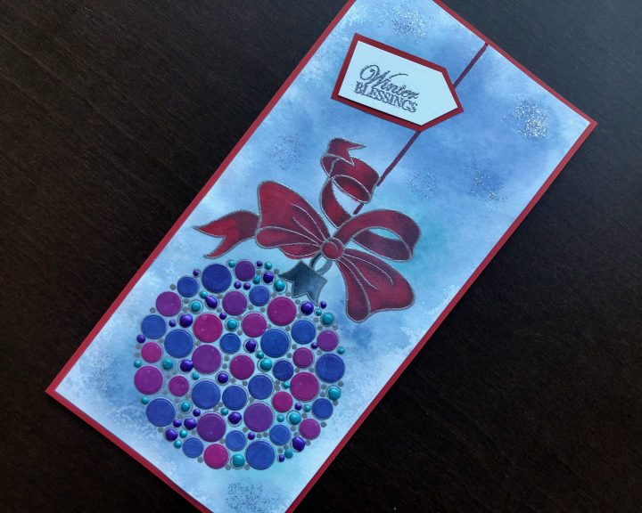 Hand made Christmas card with large stamped bauble and inked background