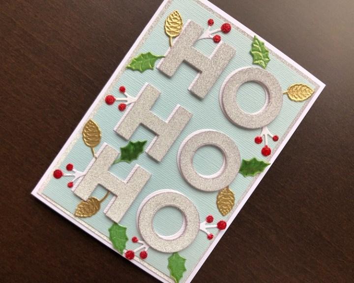 Christmas card with die cut Ho Ho Ho and winter foliage