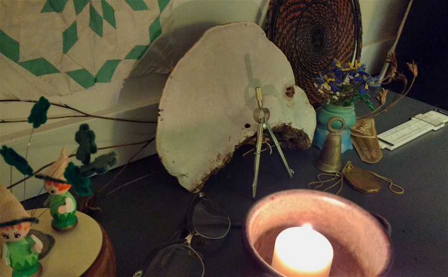 ancestors altar with candles and small memoribilia