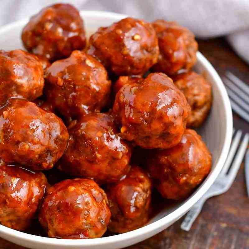 bowl of cocktail meatballs with chili and grape jelly sauce