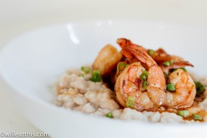 Shrimp confit served on mashed white beans and drizzled with oil.