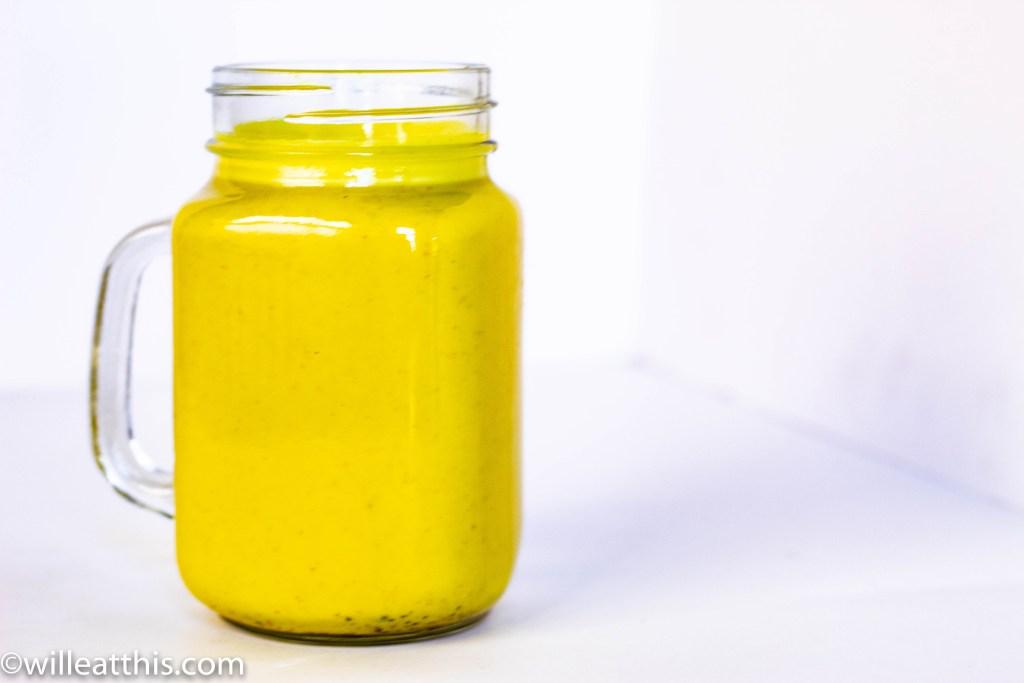 Golden Turmeric Milk in a transparent glass jar