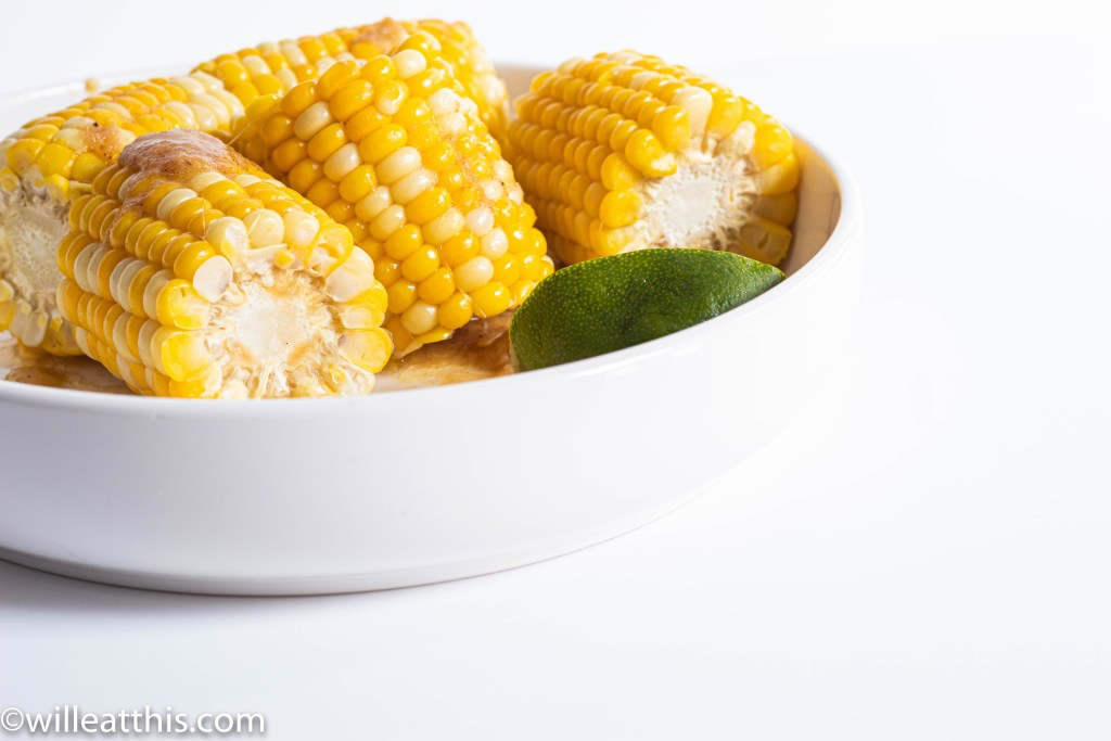 Corn with Miso Lime Butter with a wedge of lime